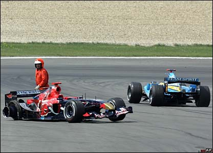 Vitantonia Liuzzi's damaged car is watched by a marshal