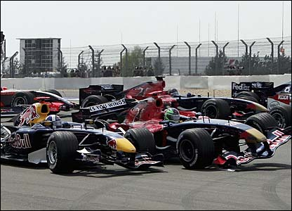 David Coulthard's Red Bull is hit by Vitantonia Liuzzi's Toro Rosso