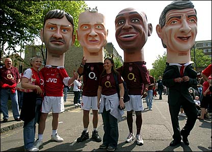 Fans arrive dressed as (l-r) Tony Adams, Dennis Bergkamp, Thierry Henry and Arsenal manager Arsene Wenger