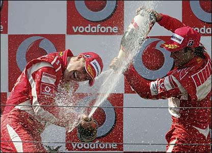 Michael Schumacher and Felipe Massa celebrate