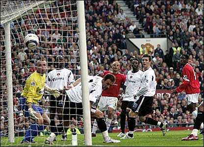 Luis Saha (right) heads in Manchester United's opener against Charlton