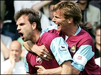 West Ham goalscorer Carl Fletcher is congratulated by Teddy Sheringham