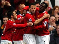 United's players celebrate Louis Saha's opener
