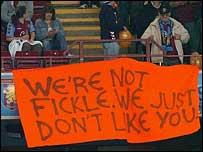 Aston Villa supporters display a banner at Villa Park