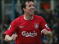 Liverpool striker Robbie Fowler celebrates scoring