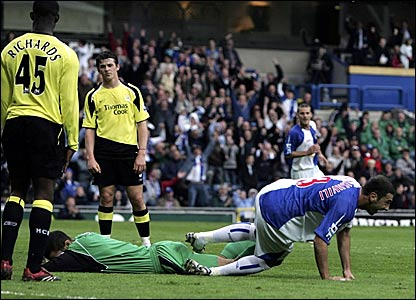 Manchester City keeper David James lies on the ground as Zurab Khizanishvili sets off to celebrate his goal