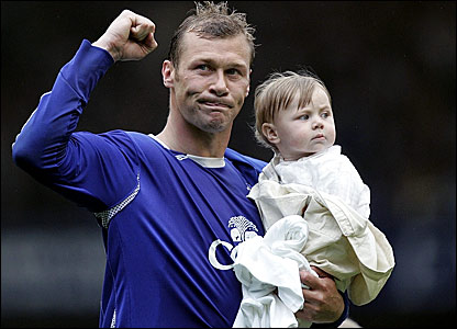 Duncan Ferguson salutes the Everton fans with his daughter after the 2-2 draw with West Brom