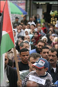 Palestinians protest over unpaid government workers' salaries in Nablus on Saturday