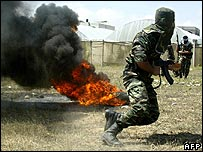 Fatah militants undergo military training in farmland close to Rafah, in the southern Gaza Strip, on 3 May