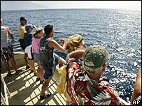 Tourists whale watching off the coast of Maui