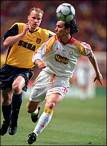 Dennis Bergkamp (left) chases a ball in the 2000 Uefa Cup final