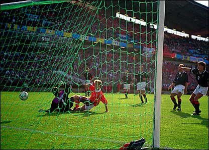 Dennis Bergkamp scores against Scotland in the Euro 92 Championship - the Dutch eventually bow out on penalties to Denmark