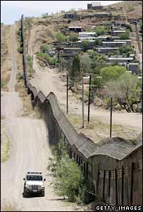 A US patrol drives along the US-Mexican border in Nogales, Arizona