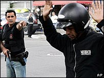 Police officer stops a suspect at a checkpoint in Sao Paulo, Brazil, on Tuesday