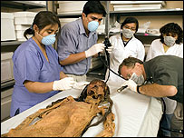 Archaeologists inspect the Moche mummy (Photo provided by the National Geographic Society)
