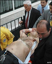 The vice president of Turkey's Council of State, Mustafa Birden, is carried to an ambulance after being shot
