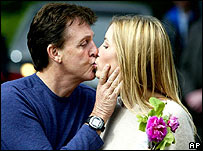 Sir Paul McCartney and Heather Mills pose for cameras the day before their wedding