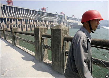 A Chinese construction worker in front of the Three Gorges Dam