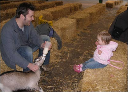 Bethan Holloway's husband and daughter enjoying the goat feeding at Folly Farm