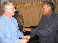 UK minister Hilary Benn and Abdullahi Yusuf