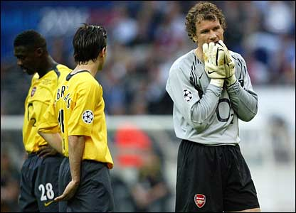 Arsenal's Jens Lehmann leaves the pitch after receiving a red card