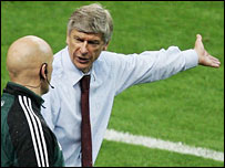 Arsenal boss Arsene Wenger contests a decision