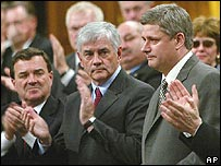 PM Harper is applauded by lawmakers after the vote passed
