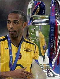 Henry walks past the trophy after claiming his runners-up medal
