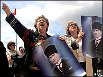 Protesters with posters of Ataturk