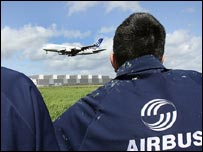 Staff at Airbus' Broughton plant watch at the A380 flies past