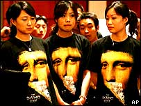 Chinese models in Da Vinci Code t-shirts in Beijing