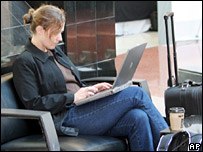 Lady using a laptop in an airport
