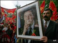 Pro-independence supporter with photo of Prime Minister Milo Djukanovic
