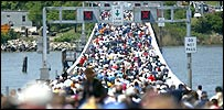Crowd crossing bridge
