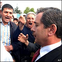 Turkish deputy PM Sener is greeted by angry crowds