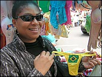 Market stall customer with Brazil G-string