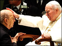 Pope John Paul II gives his blessing to Father Marcial Maciel in 2004