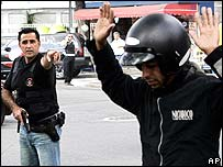 Police stopping motorcycle rider