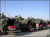 Coffins of Canadian soldiers loaded onto armoured vehicles