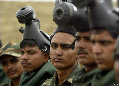 Indian soldiers participate in a drill on the outskirts of Ludhiana in India's Punjab