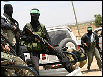 Hamas forces arriving at Rafah checkpoint (AFP)