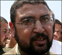 Sami Abu Zuhri speaks to reporters at Rafah (AFP)