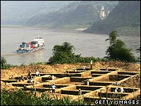 Workers work at an archaeological site, which will be submerged by the Three Gorges Dam Reservoir at Tuanjie Village of Shituo Township on May 17, 2006 in Fuling District of Chongqing Municipality, C