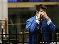 A Wall Street trader takes a rest from the week's exertions