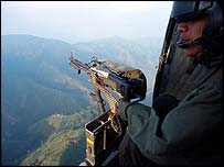 Helicopter gunner looks out over mountains
