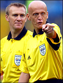 Graham Poll (left) and Pierluigi Collina
