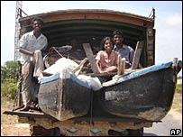 Tamils from Allaipiddy village in Jaffna leave with their belongings