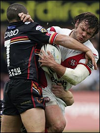 Keiron Cunningham takes on Bradford's Paul Deacon