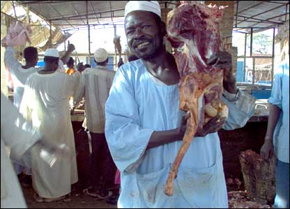 Man carrying meat at a meat market in Darfur, sent in by BBC News website reader Rob Rolfe