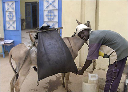 Sudanese water seller and his donkey in Darfur, sent in by BBC News website readers Fred and Aileen Knip